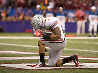 Daniel Herron of Ohio State sit on his knee after scoring a touchdown during the game against Arkansas during 77th Annual Allstate Sugar Bowl Classic at Louisiana Superdome in New Orleans, Louisiana on January 4th, 2011.  Ohio State defeated Arkansas, 31-26.