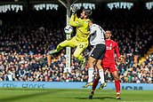 17th March 2019, Craven Cottage, London, England; EPL Premier League football, Fulham versus Liverpool; Alisson Becker of Liverpool spills the ball as he is under pressure from Aleksandar Mitrovic of Fulham