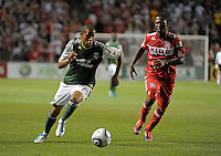 Portland defender Jeremy Hall (17) speeds away from Chicago forward Patrick Nyarko (14).  The Portland Timbers defeated the Chicago Fire 1-0 at Toyota Park in Bridgeview, IL on July 16, 2011.