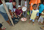 Freshly caught fish are sold in Bacubac, a seaside neighborhood in Basey in the Philippines province of Samar that was hit hard by Typhoon Haiyan in November 2013. The storm was known locally as Yolanda. The ACT Alliance has been providing a variety of assistance to survivors here.
