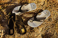 The slippers of a young engaged couple, Kailua Beach Park, Windward O'ahu.