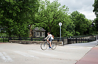 Brayden Hamilton of Springdale rides, Saturday, May 16, 2020 along Johnson Ave. in Springdale. Springdale will partner with the Downtown Springdale Association for sidewalk improvement on Johnson, Commercial and Spring streets.