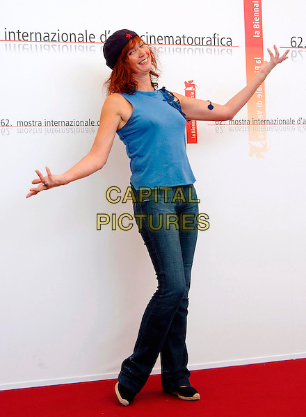 "SABINE AZEMA.Photocall for film ""Le Parfum de la Dame Noire"".62nd Venice Film Festival.September 7th, 2005.full length arms outstretched jeans denim blue purple sleeveless top hat gesture.www.capitalpictures.com.sales@capitalpictures.com.© Capital Pictures."