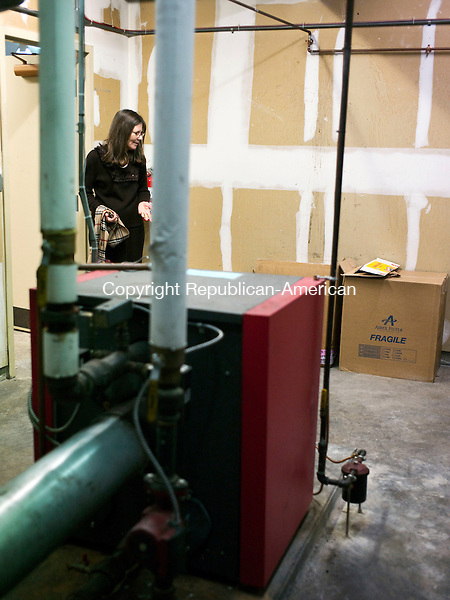 Harwinton, CT- 21 January 2016-012116CM05- Mary Bulat, children's librarian at the Harwinton Public Library talks about the furnace at the library in Harwinton on Thursday.  The library has requested $190,000 for detailed construction and design plans to determine a more accurate estimate for a construction project.  The plan is expected to help the building become more energy efficient and provide other improvements.    Christopher Massa Republican-American
