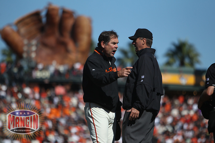 SAN FRANCISCO - October 2:  Manager Bruce Bochy of the San Francisco Giants argues with umpire Tim McClelland during the game against the San Diego Padres at AT&T Park on October 2, 2010 in San Francisco, California. (Photo by Brad Mangin)