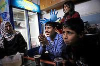 Syria, Deir az-Zor, 2013/03/21..Teenager Wissam (real name withheld) at his work in Al-Noor Hospital in central Deir az-Zor. It's  the largest hospital in town to treat injured or register deads from fightings or shelling in the embattled town at the banks of Eurphrates river. Conditions are poor and all staff works since two years almost non-stop. Even skilled teenager are needed to maintain proceedings as Wissam fullfills his job for his age in an incredible manner..Syrie, Deir ez-Zor, 21/03/2013.L'adolescent Wissam (son nom a été changé) à son travail à l'hôpital Al-Noor dans le centre de Deir az-Zor. Il s'agit du plus grand hôpital de la ville pour soigner les blessés ou enregistrer les  morts aux combats ou lors de bombardements dans la ville assiégée. Les conditions sont mauvaises et l'ensemble du personnel travaille depuis deux ans presque non-stop. Même l'emploi d'adolescents est nécessaire pour maintenir les services ouverts à l'image de Wissam qui fait son travail d'une manière incroyable pour un garçon de cet âge..Photo: Timo Vogt / Est&Ost Photography..