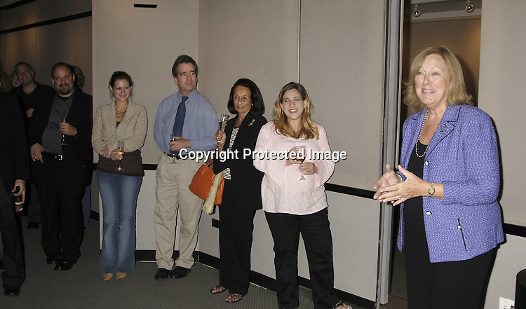 Mary Alice Dwyer-Dobbin and the crowd..at at reception in honor of Mary Alice Dwyer-Dobbin on her ..leaving P and G on September 29, 2005 at the offices of ..P and G. ..Photo by Robin Platzer, Twin Images