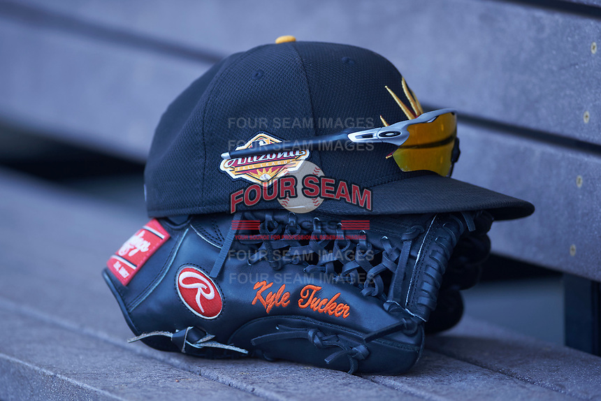 The hat, sunglasses, and glove of Mesa Solar Sox outfielder Kyle Tucker (not pictured) rests on the bench during an Arizona Fall League game against the Glendale Desert Dogs on October 28, 2017 at Sloan Park in Mesa, Arizona. The Solar Sox defeated the Desert Dogs 9-6. (Zachary Lucy/Four Seam Images)