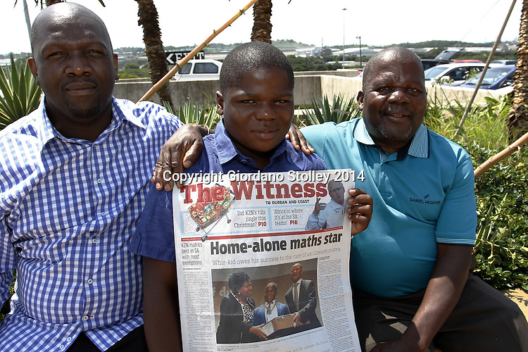 DURBAN - 9 January 2014 - Durban businesman Xolani Mbutho (right) read about Lwazi Shezi's (centre) remarkable achievement to get the top maths mark in the Witness and decided to get his company to sponsor Lwazi's university studies. His dad, Aaron Shezi, looks on. Picture: Allied Picture Press/APP