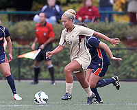 Boston College forward Rachel Davitt (24) dribbles under pressure. Pepperdine University defeated Boston College,1-0, at Soldiers Field Soccer Stadium, on September 29, 2012.
