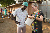 Occidental College professor Mary Beth Heffernan works on her PPE Portrait Project at ELWA II's Ebola Treatment Unit (ETU) in Monrovia, Liberia on Sunday, March 1, 2015. Her project involves photographing health care workers and then making disposable, adhesive prints of their images, which are then placed on the worker's PPE (personal protective equipment) used to protect themselves when caring for patients.<br /> ELWA II has one of the largest numbers of Ebola patients in Liberia at the moment and was the first ETU to open in Monrovia, Liberia's capital city.<br /> (Photo by Marc Campos, Occidental College Photographer) Mary Beth Heffernan, professor of art and art history at Occidental College, works in Monrovia the capital of Liberia, Africa in 2015. Professor Heffernan was there to work on her PPE (personal protective equipment) Portrait Project, which helps health care workers and patients fighting the Ebola virus disease in West Africa.<br />