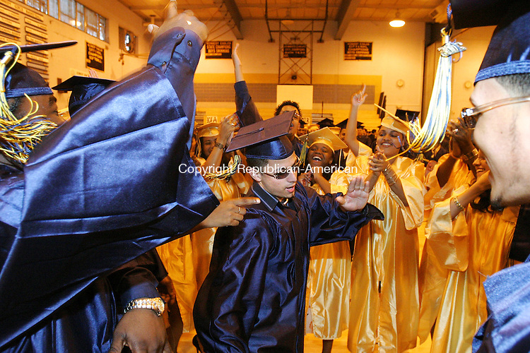 WATERBURY, CT -24 June 2005 -062405BZ09-  Nelson Roman, center, dances in a circle of soon to be graduates minutes before the start of commencement excercises at Kennedy High Friday.<br /> Jamison C. Bazinet Photo