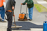 construction workers laying asphalt