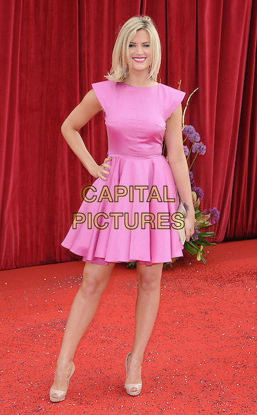 SARAH JAYNE DUNN .At the British Soap Awards 2011, Granada TV Studios, Manchester, England, UK, MaY 14th 2011..arrivals full length pink dress hand on hip clutch  bag smiling beige peep toe shoes .CAP/CAN.©Can Nguyen/Capital Pictures.