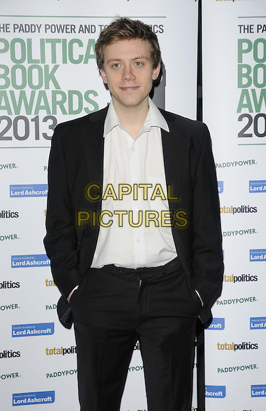 Owen Jones.The Paddy Power & Total Politics Political Book Awards 2013, BFI Imax, Charlie Chaplin Walk, London, England..February 6th, 2013.half length black suit white shirt hands in pockets .CAP/CAN.©Can Nguyen/Capital Pictures.