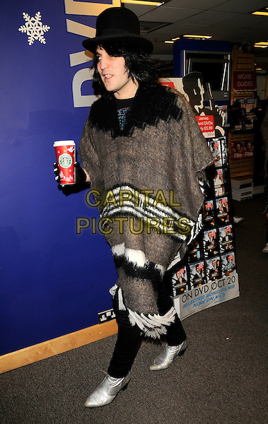 NOEL FIELDING.The Mighty Boosh booksigning session, Boprders bookshop, Oxford Street,  London, England..December 15th, 2008.book signing full length black hat starbucks drink beverage brown white black poncho wrap silver shoes.CAP/CAN.©Can Nguyen/Capital Pictures.