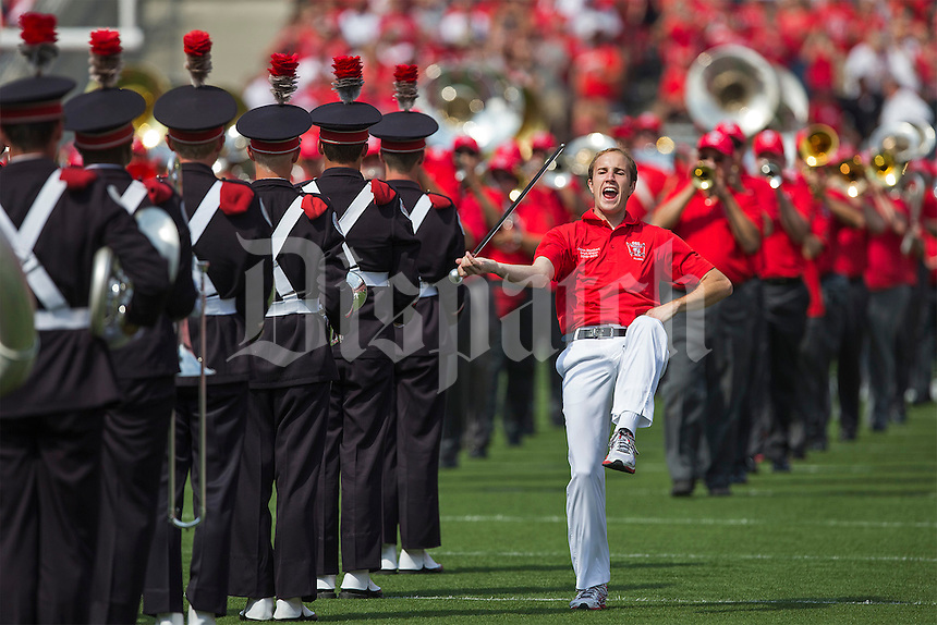 Jason Stuckert, a drum major from 2010 to 2011, leads the OSU Alumni Band into the Ohio Stadium before the NCAA football game at Ohio Stadium in Columbus on Sept. 7, 2013. (Alex Holt / The Columbus Dispatch)