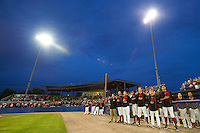 Batavia Muckdogs players and fans stand for God Bless America in the 7th inning during a game against the Mahoning Valley Scrappers on July 3, 2015 at Dwyer Stadium in Batavia, New York.  Batavia defeated Mahoning Valley 7-4.  (Mike Janes/Four Seam Images)