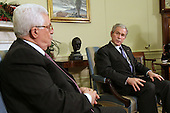 Washington, DC - December 19, 2008 -- United States President George W. Bush, right, meets with the President Mahmoud Abbas (Abu Mazen), left, of the Palestinian Authority in the Oval Office of the White House in Washington DC on Friday, December 19, 2008..Credit: Ken Cedeno / Pool via CNP