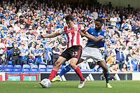 Luke O'Nien of Sunderland lays the ball off under pressure from Janoi Donacien of Ipswich Town during Ipswich Town vs Sunderland AFC, Sky Bet EFL League 1 Football at Portman Road on 10th August 2019