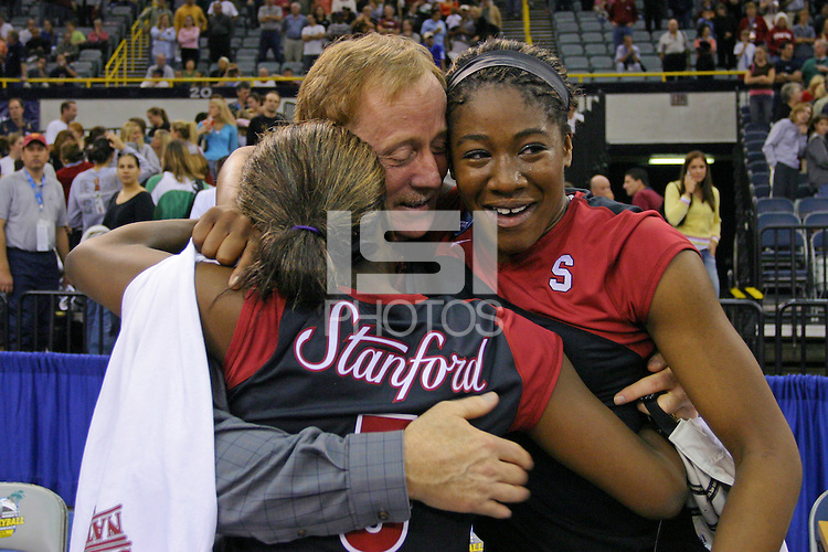 18 December 2004: Stanford Cardinal Ogonna Nnamani with head coach John Dunning and sister Njideka during Stanford's  30-23, 30-27, 30-21 victory over Minnesota in the 2004 NCAA Women's Volleyball National Championships in Long Beach, CA. Stanford won their sixth women's volleyball title in school history. Nnamani was named the tournament's Most Outstanding Player and broke the tournament record for kills.<br />
