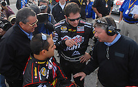 Feb 11, 2007; Daytona, FL, USA; Nascar Nextel Cup driver Juan Pablo Montoya (42) talks with teammate David Stremme (40) co-owner Felix Sabates and team engineer Tony Glover during qualifying for the Daytona 500 at Daytona International Speedway. Mandatory Credit: Mark J. Rebilas