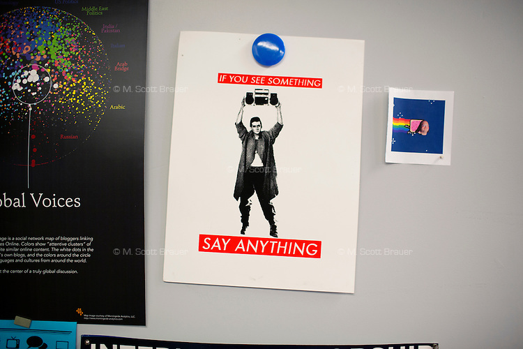 """Posters decorate Professor Ethan Zuckerman's office door in the Center for Civic Media at MIT's Media Lab in Cambridge, Massachusetts, USA.  Zuckerman is director of the Center for Civic Media.  One poster has John Cusack from the movie """"Say Anything"""" and reads """"If you see something / Say anything."""""""