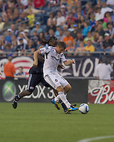 Chicago Fire forward Brian McBride (20) passes as New England Revolution midfielder Shalrie Joseph (21) pressures. The Chicago Fire defeated the New England Revolution, 1-0, at Gillette Stadium on June 27, 2010.