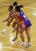 Pulse wing attack Ngarama Milner-Olsen and Mystics wing defence Finau Pulu compete for the ball during the ANZ Netball Championship match between the Central Pulse and Northern Mystics, TSB Bank Arena, Wellington, New Zealand on Monday, 4 May 2009. Photo: Dave Lintott / lintottphoto.co.nz