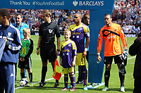 Pictured: Ashley Williams and mascot (C).<br />