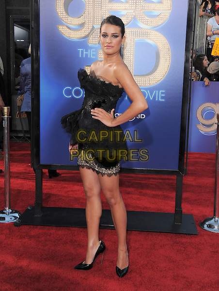Lea Michele.attends The 20th Century Fox 'Glee 3D' Concert World Movie Premiere held at The Regency Village theatre in Westwood, California, USA, .August 6th 2011..full length ponytail  dress strapless black hair up tulle  lace tiered ruffles  pointy shoes heels walking mini hand on hip .CAP/RKE/DVS.©DVS/RockinExposures/Capital Pictures.