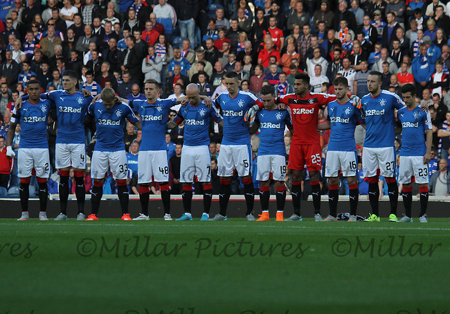 Rangers players in the minutes silence for the late Sammy Cox in the Rangers v St Mirren Scottish Professional Football League Ladbrokes Championship match played at Ibrox Stadium, Glasgow on 7.8.15.