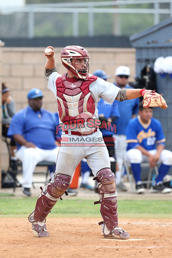 Chris Betts (26) of Long Beach Wilson High School, and a potential first round draft pick in the 2015 draft, plays in the field at catcher during a game against Gahr High School at Gahr H.S. on March 18, 2015 in Cerritos, California. (Larry Goren/Four Seam Images)