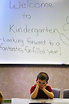 Sammy Vidal, 5, sits in Ms. Judy Koech's kindergarten class as the first day of school begins at the Academies of Excellence charter school in Bunnell, Fla., Wednesday, Aug. 11, 2004.(Brian Myrick)