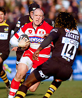 Mike Tindall faces off against Paul Sackey on his way to the Wasps line. Guinness Premiership match between London Wasps and Gloucester on March 7, 2010 at Adams Park in High Wycombe, England. [Mandatory Credit: Patrick Khachfe/Onside Images]