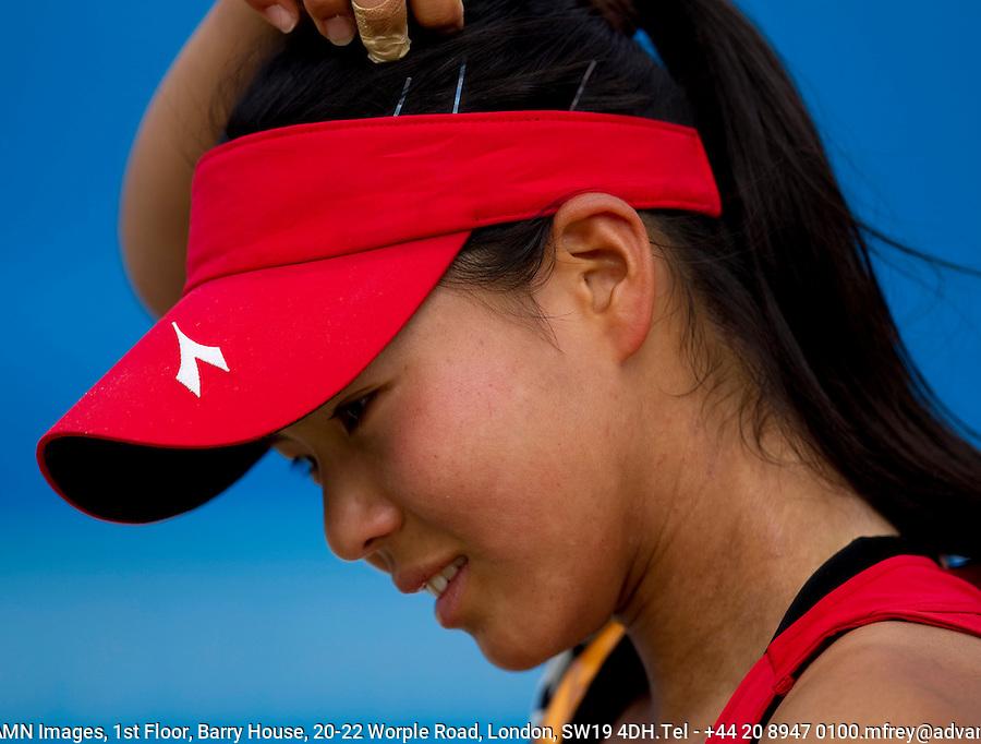 Risa Ozaki (JPN) against Karolina Pliskova (CZE) (6) in the third round Junior Girls Singles. Pilskova beat Ozaki 6-4 6-2..International Tennis - Australian Open Tennis -  Wednesday 27th  Jan 2010 - Melbourne Park - Melbourne - Australia ..© Frey - AMN Images, 1st Floor, Barry House, 20-22 Worple Road, London, SW19 4DH.Tel - +44 20 8947 0100.mfrey@advantagemedianet.com
