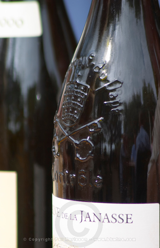 A bottle with the symbol of the appellation moulded glass on the neck, with pope's mitre and keys. On a bottle of Domaine de la Janasse. The restaurant Le Verger de Papes in Chateauneuf-du-Pape Vaucluse, Provence, France, Europe
