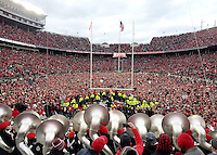 Ohio State Buckeyes fans and Brutus Buckeye crowd the field after Ohio State beat Michigan in double overtime 30-27 in the NCAA football game between the Ohio State Buckeyes and the Michigan Wolverines at Ohio Stadium on Saturday, November 26, 2016.  (Dispatch photo by JD Malone)