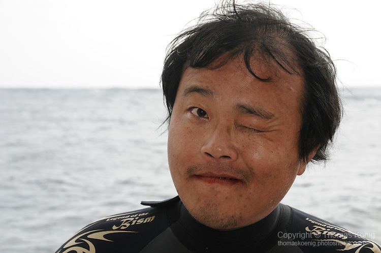 Gun Shui Bi, Green Island -- The local dive guide, Ai Chian, however, is in high spirits.