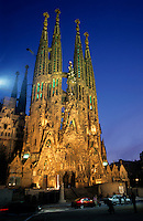 Facade of the famous Sagrada Familia cathedral at dusk, Barcelona, Spain.