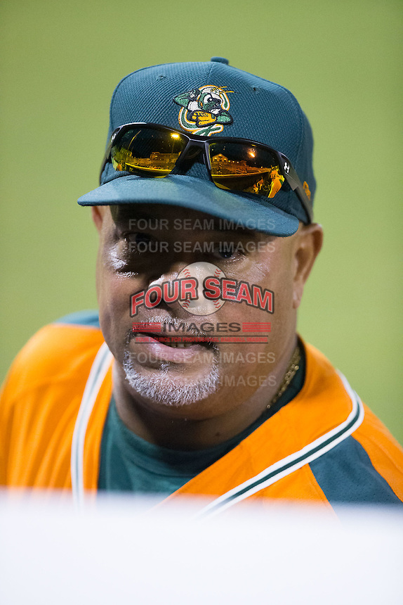 Greensboro Grasshoppers hitting coach Luis Quinones (19) during the game against the Kannapolis Intimidators at CMC-Northeast Stadium on June 11, 2015 in Kannapolis, North Carolina.  The Intimidators defeated the Grasshoppers 7-6.  (Brian Westerholt/Four Seam Images)