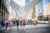 Street level entrance to the World Trade Center Transportation Hub, known as the Oculus, opens to the public on Sunday, September 4, 2016, 2016. The over-budget, years late, $4 billion state-of-the-art transportation hub was designed by renowned architect Santiago Calatrava. When finished the hub will connect subway lines and PATH trains. (© Richard B. Levine)