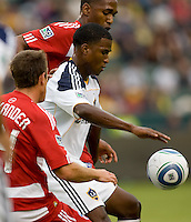 Edson Buddle forward of the LA Galaxy battles with FC Dallas players Eric Alexander (front) and Atiba Harris (rear). The LA Galaxy defeated FC Dallas 2-1 at Home Depot Center stadium in Carson, California on Sunday October 24, 2010.