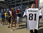 (Foxboro 070613) Rebecca Habershaw of Rehoeoth, holds up her Aaron Hernandez jersey, while waiting in line during an exchange of Aaron Hernandez jerseys Saturday at the pro shop at Gillette Stadium in Foxboro.  (Jim Michaud Photo) For Sunday