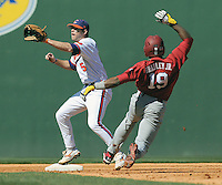 Clemson second baseman Mike Freeman (5) takes the throw as USC center fielder Jackie Bradley Jr. (19) is thrown out stealing second during a game between the Clemson Tigers and South Carolina Gamecocks Saturday, March 6, 2010, at Fluor Field at the West End in Greenville, S.C.