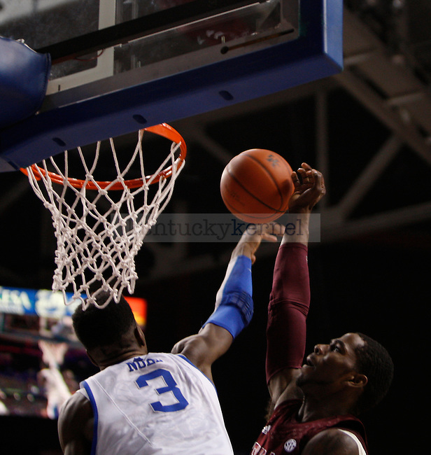Freshman forward Nerlens Noel blocks the ball during the Men's University of Kentucky basketball game against Texas A&M at Rupp Arena on January 12th, 2013. Photo by Kirsten Holliday | Staff