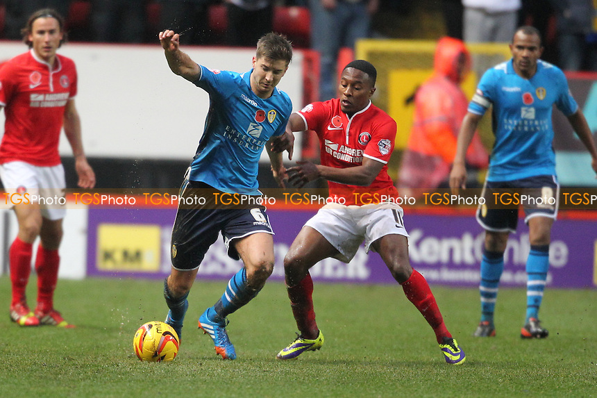 Luke Murphy of Leeds United comes under pressure from Callum Harriott of Charlton Athletic - Charlton Athletic vs Leeds United - Sky Bet Championship Football at The Valley, London - 09/11/13 - MANDATORY CREDIT: Simon Roe/TGSPHOTO - Self billing applies where appropriate - 0845 094 6026 - contact@tgsphoto.co.uk - NO UNPAID USE