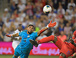 Jose Calderon (12) of Panama grabs for the ball just before Jozy Altidore (17) of the United States does a bicycle kick and scores during their Gold Cup match on June 26, 2019 at Children's Mercy Park in Kansas City, KS.<br /> Tim VIZER/AFP