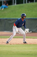 Potomac Nationals pinch runner Edwin Lora (10) leads off first base during the first game of a doubleheader against the Lynchburg Hillcats on June 9, 2018 at Calvin Falwell Field in Lynchburg, Virginia.  Lynchburg defeated Potomac 5-3.  (Mike Janes/Four Seam Images)