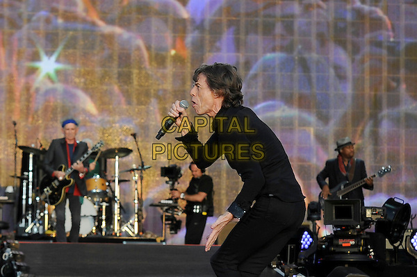 Mick Jagger of The Rolling Stones <br /> performing at Barclaycard British Summertime, Hyde Park, London, England, UK, <br /> 13th July 2013.<br /> music concert gig festival live on stage half length black shirt microphone  singing side <br /> CAP/MAR <br /> &copy; Martin Harris/Capital Pictures